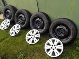 Продам комплект колёс на штамповке 215/65/16 Dueler h|t 687  2011г. c колпаками